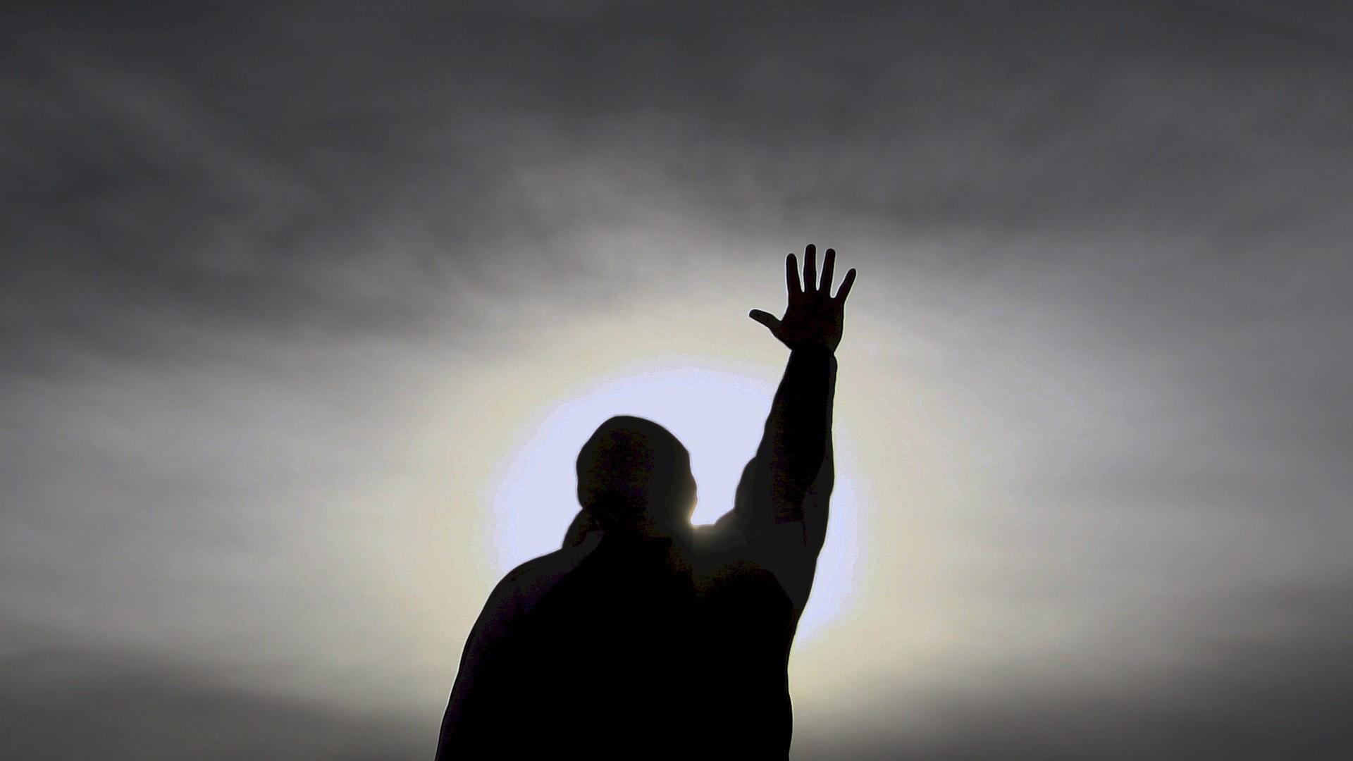 man-praying-whand-raised